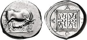 Illyrian coinage - Apollonia's coin. A cow and a suckling calf. Reverse: double stellate pattern within dual linear border and the inscription A Π O Λ around.