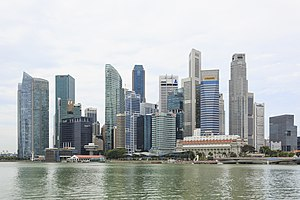The skyline of a city, showing many tall buildings near a body of water