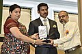 Smriti Irani presenting the Rajat Kamal Award to Bhupender Kainthola (Best Film on Family ValuesSpecial Jury) for the Non-Feature film –MONDAY (Shared), at the 65th National Film Awards Function, in New Delhi.JPG