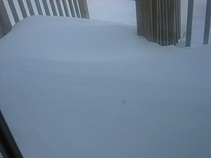 Mid-December 2007 North American winter storms - Snowdrifts covering deck outside a front door in Southern Ontario.