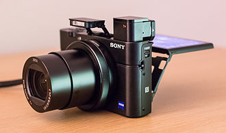 Sony Cyber-shot DSC-RX100 - A DSC-RX100 III camera showing the extended positions of the lens, flash, electronic viewfinder, and LCD panel.