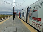 Southbound TRAX Red Line at 5600 W Old Bingham Hwy station, Apr 16.jpg