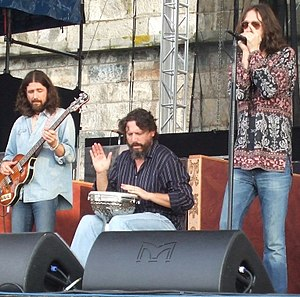 Steve Gorman - Gorman (center) performing with fellow members of The Black Crowes, Sven Pipien and Chris Robinson, at the 2008 Newport Folk Festival.