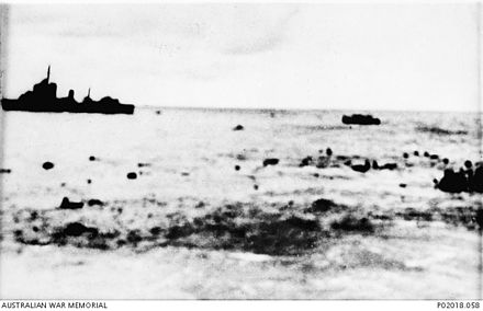 Survivors from Prince of Wales and Repulse in the water as a destroyer moves in for the rescue. Survivors in water.jpg