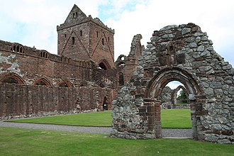 Sweetheart Abbey - Sweetheart Abbey entrance through the much altered archway in the abbey precincts which extended to 30 acres.