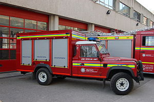 Squad truck - Avon Fire and Rescue Service's line rescue Land Rover parked outside Temple fire station in Bristol.