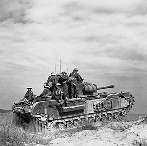 Italian Co-belligerent Army - Churchill tank of 'C' Squadron, North Irish Horse carrying Italian infantry of 3rd Battalion, 21st Infantry (Italian), north of Castel Borsetti, 2 March 1945