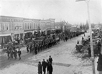 Byron, Michigan - Soldiers and veterans of the Detroit Light Guard march in a funeral in Byron, 1900