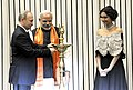 "The Prime Minister, Shri Narendra Modi and the President of Russian Federation, Mr. Vladimir Putin lighting the lamp to inaugurate the ""World Diamond Conference"", in New Delhi on December 11, 2014.jpg"