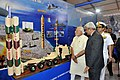 The Prime Minister, Shri Narendra Modi visiting the Maritime Exhibition at International Fleet Review 2016 venue, in Visakhapatnam on February 06, 2016. The Chief of Naval Staff, Admiral R.K. Dhowan is also seen (2).jpg