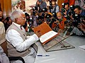 The Union Minister for Railways, Shri Lalu Prasad giving finishing touches to the Railway Budget 2005-06 in New Delhi on February 25, 2005.jpg