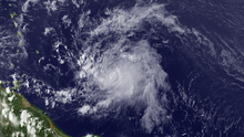 A visible satellite image of a fast-moving and weak tropical storm in the central Atlantic.