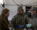 U.S. Air Force Maj. Deb Massey, center, and Master Sgt. Katie Stewart, right, with the 133rd Medical Group, Minnesota Air National Guard, have a discussion with a role player in a chemical enhanced response 130522-Z-LY731-532.jpg