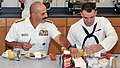 U.S. Navy Rear Adm. Mark D. Guadagnini, left, deputy commander with fleet management and chief of staff of U.S. Fleet Forces Command, talks with his nephew, Seaman Recruit Frank Guadagnini, during a breakfast at 120817-N-IK959-062.jpg