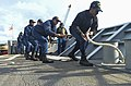 U.S. Sailors perform line handling duties as the guided missile cruiser USS Monterey (CG 61) arrives in Livorno, Italy, April 22, 2013, for a port visit 130422-N-QL471-028.jpg