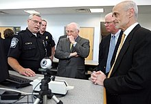A U.S. Customs and Border Protection Officer addresses Dick Cheney  (center) 12082a0c85