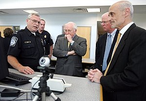 United States Department of Homeland Security - A U.S. Customs and Border Protection Officer addresses Dick Cheney (center), then Vice President of the United States, Saxby Chambliss (center right), a U.S. senator from Georgia and Michael Chertoff (far right), then United States Secretary of Homeland Security in 2005