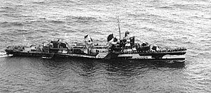 USS Hudson (DD-475) rescueing a downed aircrew off Guam on 21 July 1944 (80-G-248291)