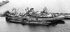 USS Pelias (AS-14) - Pelias with submarines in Australia, circa 1943.