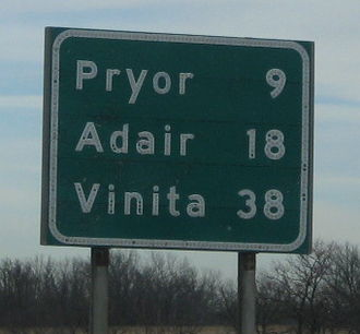 Button copy - A distance sign in Oklahoma using button copy