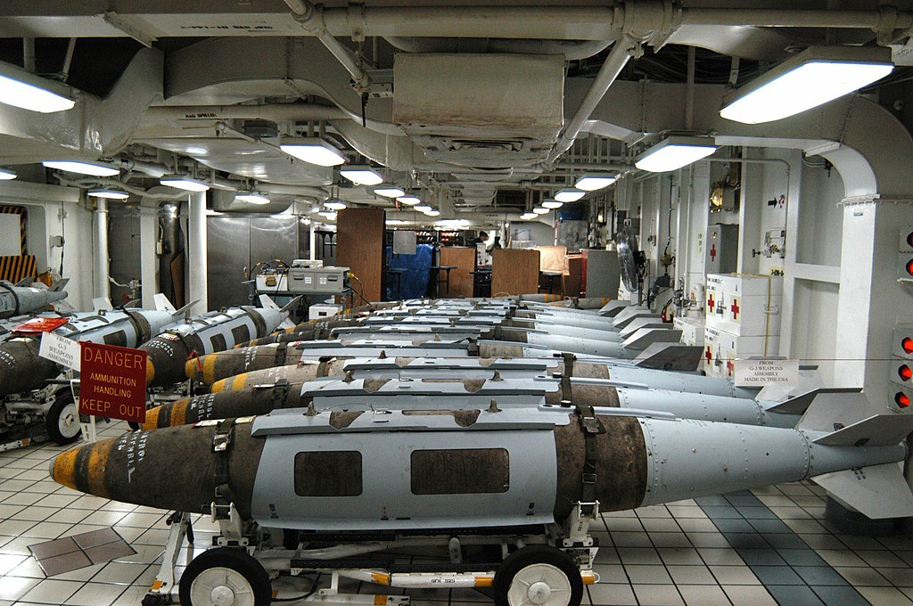 US Navy 030320-N-9228K-002 Joint Direct Attack Munitions (JDAM) sit on the mess decks in temporary storage prior to being moved to the flight deck to be loaded onto awaiting air wing aircraft.jpg