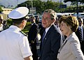 US Navy 031023-N-7590D-079 President George W. Bush and First Lady Laura Bush are greeted by Captain Ronald R. Cox, Commander Naval Station Pearl Harbor Hawaii, during the Presidents visit with veterans and service members.jpg