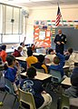 US Navy 040324-N-5027S-003 Chief Fire Controlman Jose Castillo, assigned to the amphibious assault ship USS Saipan (LHA-2), meets with students at Meadowbrook Elementary School in Eatontown, N.J.jpg