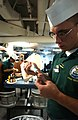 US Navy 040721-N-1573O-022 Culinary Specialist 3rd Class Kyle Blatchley of New Port Richey, Fla., creates one of many roses for a cake that are baked aboard USS John C. Stennis (CVN 74) each day.jpg