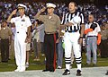 US Navy 040827-N-9214G-052 Commander, Naval Air Force, U.S. Pacific Fleet, Vice Adm. James M. Zortman, left, salutes during the playing of the National Anthem.jpg