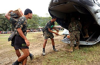 Real, Quezon - Image: US Navy 041210 M 1188A 007 U.S. Marines and Philippine Army recruits unload boxes of bottled water from a CH 46E Sea Knight helicopter