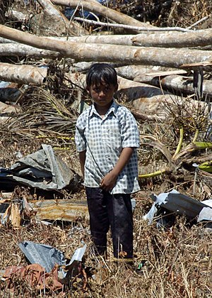 Calang - An Indonesian child stands amid the destruction of the tsunami in the village of Calang, Sumatra, Indonesia