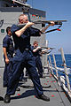 US Navy 050326-N-3614M-148 Sonar Technician 1st Class Christopher Fromknecht fires a Mossberg 12-gauge shotgun from the forecastle of the guided missile frigate USS Gary (FFG 51).jpg