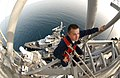 US Navy 050508-N-5526M-005 High on the main mast aboard the guided missile cruiser USS Normandy (CG 60), Electronics Technician 2nd Class Ryan A. Legge from Reno, Nev., checks radar assemblies for corrosion.jpg