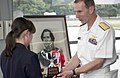 US Navy 050520-N-9851B-012 Commander Naval Forces Japan, Rear Admiral Frederic Ruehe presents a trophy to a Shimoda high school student for winning an art contest in honor of the sixty sixth annual Black Ship Festival.jpg