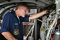 US Navy 050823-N-3207B-001 Aviation Electrician's Mate 2nd Class Jason Hauser, assigned to Patrol Squadron Four Seven (VP-47), replaces wiring on a P-3C Orion engine.jpg