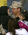 US Navy 060219-N-9500T-035 Boatswain's Mate 2nd Class Sergio Lopez assigned to Beachmaster Unit One (BMU-1), embraces his loved ones after returning from a seven-month deployment.jpg