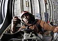 US Navy 060313-N-7981E-013 Aviation Electronics Technician 3rd Class Rolax Green applies grease to the gearbox of an SH-60B Seahawk helicopter.jpg