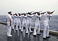 US Navy 060609-N-1745W-054 A firing squad fires three rounds during a burial-at-sea ceremony aboard the Nimitz-class aircraft carrier USS Abraham Lincoln (CVN 72).jpg