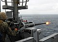 US Navy 070316-N-4124C-014 A Marine from 1st Marine Aircraft Wing (MAW) 172nd Support Squadron fires a round from a 25mm machine gun aboard dock landing ship USS Harpers Ferry (LSD 49).jpg