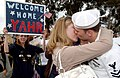 US Navy 070420-N-0555B-186 Machinery Repairman 2nd Class Brandon Yahr is welcomed home with a kiss after returning from a three-month deployment aboard USS Ronald Reagan (CVN 76).jpg