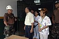 US Navy 070707-N-6278K-014 Ensign Leonard Neal, Construction Battalion Maintenance Unit (CBMU) 202 officer in charge, thanks Dr. Edgar Coto, regional director of Centro De Salud Patricia Duncan, and his staff for welcoming his.jpg