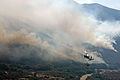 US Navy 071026-N-6597H-090 An MH-60S Seahawk, assigned to Helicopter Sea Combat Squadron (HSC) 85, carries a bucket containing 420 gallons of water to dump on a wildfire in San Diego County.jpg