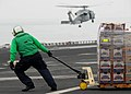 US Navy 071103-N-7981E-139 A Sailor uses a pallet jack to move newly received food stores to an aircraft elevator aboard Nimitz-class aircraft carrier USS Abraham Lincoln (CVN 72) during a vertical replenishment with USNS Henry.jpg