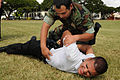 US Navy 080213-N-3415O-004 Boatswain Mate 2nd Class Antonio Ruiz and Emmanuel Dejesus, recruits at the Naval Regional Police Training Center Hawaii, conduct a suspect search.jpg