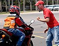 US Navy 080611-N-5345W-104 Volunteer motorcycle safety instructor Nick Brunney gives feedback to Aviation Boatswain's Mate (Handling) 2nd Class Jun DeLeon, after performing a rapid deceleration maneuvering exercise.jpg