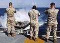 US Navy 080719-N-5681S-013 Marines take photos of a landing craft air cushion as it pulls into the multi-purpose amphibious assault ship USS Iwo Jima (LHD 7).jpg