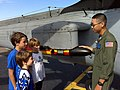 US Navy 080920-N-7443N-023 Aviation Structural Mechanic 3rd Class Andy King describes the anti-submarine capabilities of an SH-60 Sea Hawk helicopter to visitors at Owens Field in Columbia, S.C.jpg