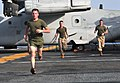 US Navy 091004-N-9740S-006 Marines assigned to the 22nd Marine Expeditionary Unit (22nd MEU) run sprints near an MV-22B Osprey.jpg