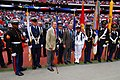 US Navy 091025-N-1854W-185 Former U.S. Presidents George H.W. Bush, center-left, and George W. Bush pose with a Joint Services Color Guard during Navy Week celebrations in Houston.jpg