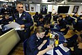 US Navy 100213-N-1688B-083 Chief Master-at-Arms Anthony Sganga administers an in-port security watch qualification test to sailors aboard the guided-missile cruiser USS Hue City (CG 66).jpg